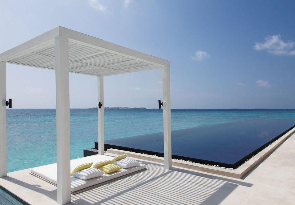 sky water chair property swimming pool Villa Ocean condominium caribbean Sea lawn shore Deck overlooking day