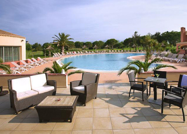 sky chair property swimming pool leisure Villa Resort backyard hacienda condominium outdoor structure Patio Deck
