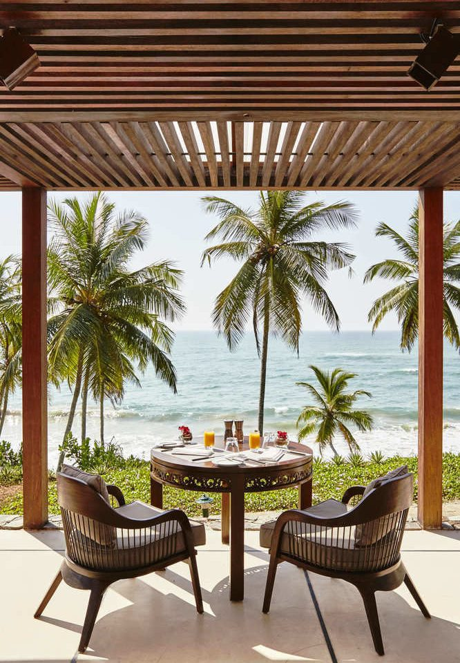 property palm Resort outdoor structure Villa home porch Patio lined Deck dining table