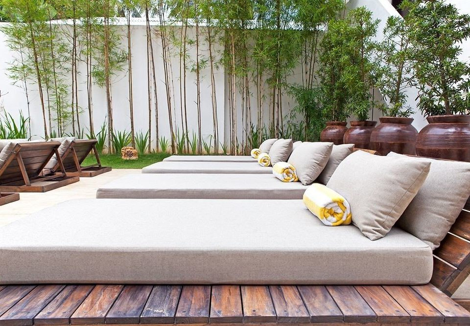 tree property sofa backyard outdoor structure hardwood seat living room swimming pool porch Deck Patio home studio couch flooring Villa arranged
