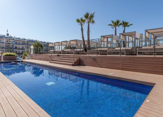 sky water Pool swimming pool property condominium Resort reflecting pool walkway swimming Deck