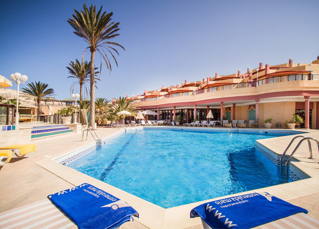 sky swimming pool Pool Resort leisure property blue Villa caribbean condominium resort town Sea palm swimming Deck