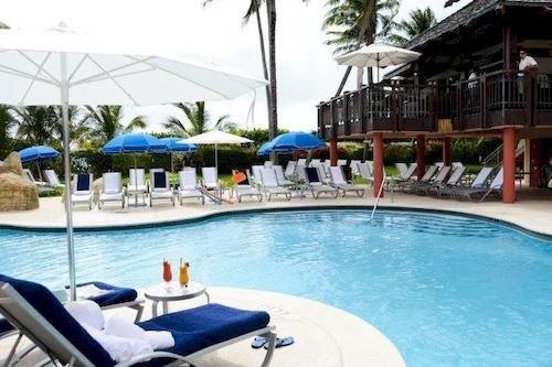 sky water swimming pool chair property Pool Resort leisure condominium Villa caribbean resort town swimming blue Deck