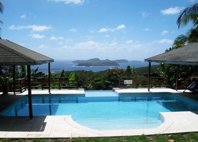 sky swimming pool Pool property leisure Resort Villa blue condominium backyard swimming caribbean Deck