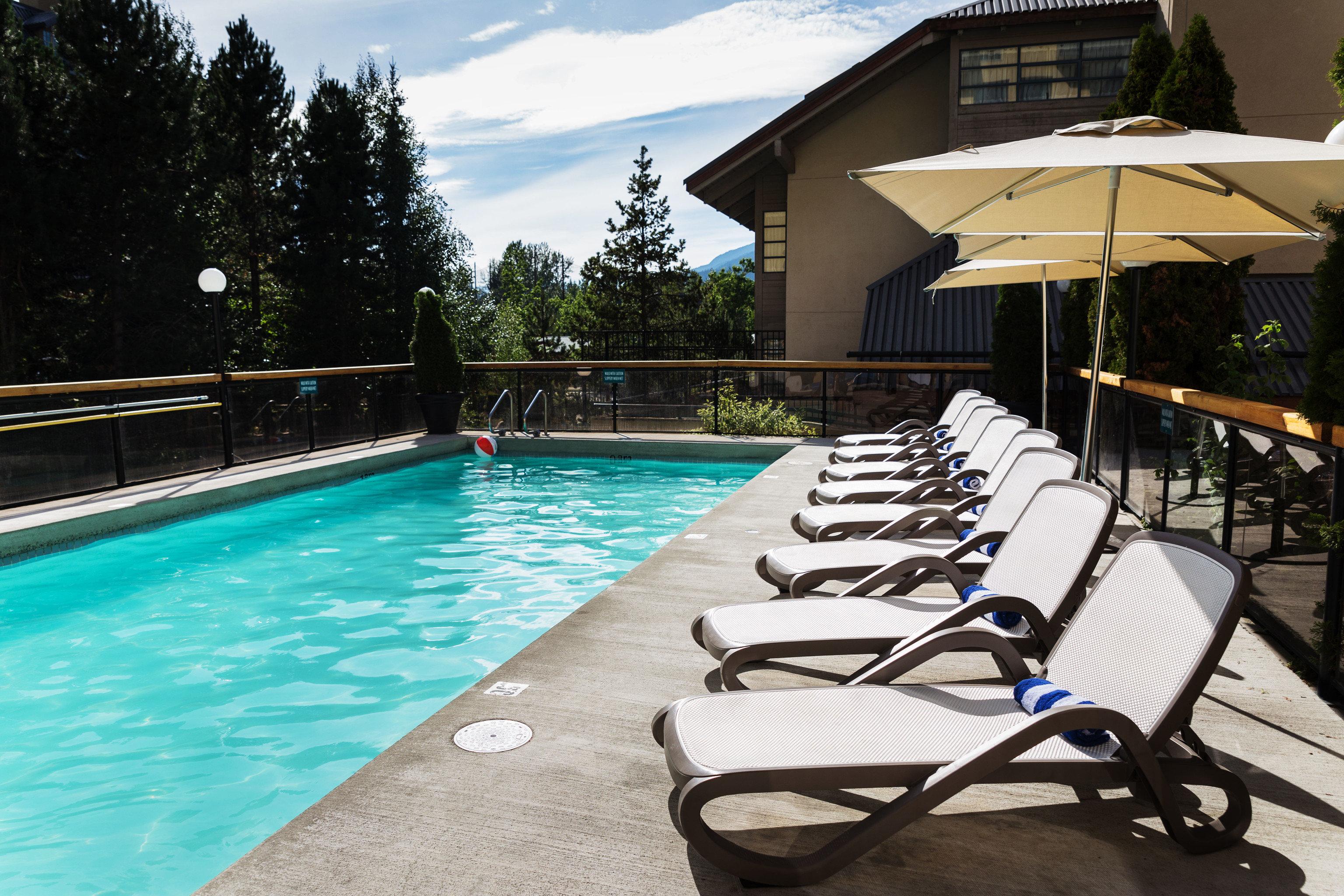 tree Pool leisure swimming pool chair property Resort Villa backyard swimming Deck day