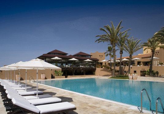 sky chair swimming pool property Resort leisure Villa condominium Pool caribbean resort town Deck lined swimming