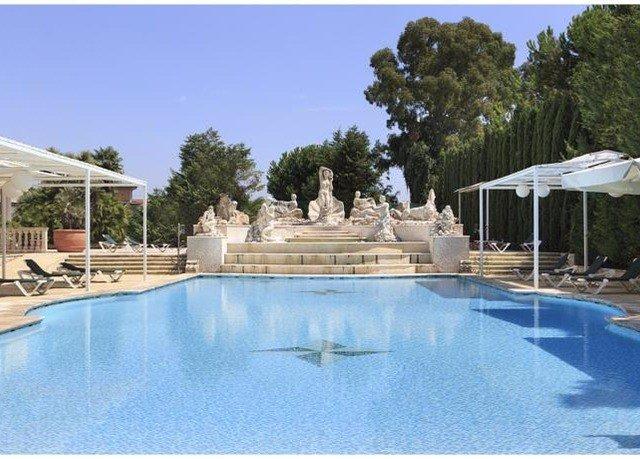 tree sky swimming pool Resort property Pool building blue reflecting pool Villa swimming Deck