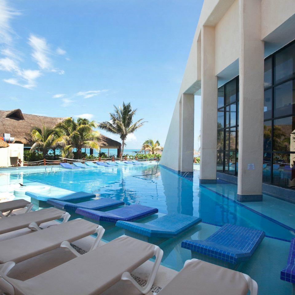 sky chair property swimming pool leisure Resort condominium blue Villa Pool lawn Deck lined