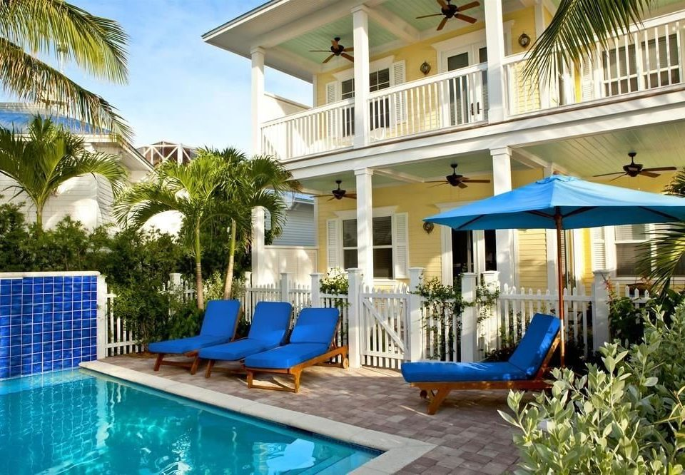 building blue tree Pool chair swimming pool property Resort Villa leisure Deck condominium home backyard caribbean mansion cottage lawn eco hotel swimming porch plastic