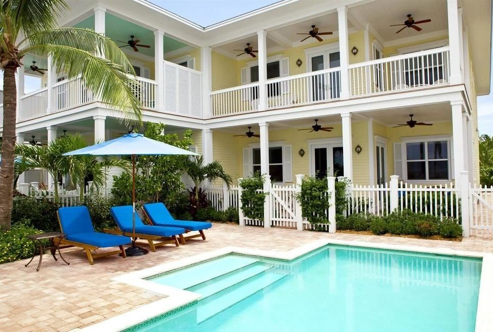 building chair property swimming pool Pool Villa condominium Resort home house backyard mansion Deck cottage outdoor structure porch swimming