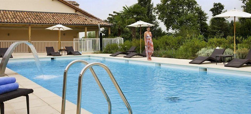 sky tree water Pool swimming pool chair leisure property building Resort Villa swimming home backyard condominium cottage blue Deck