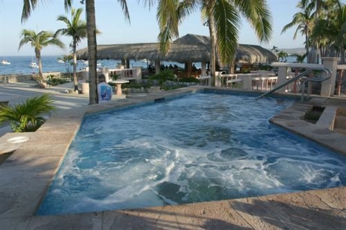 sky Resort palm swimming pool property Pool Villa condominium shore Deck lined swimming