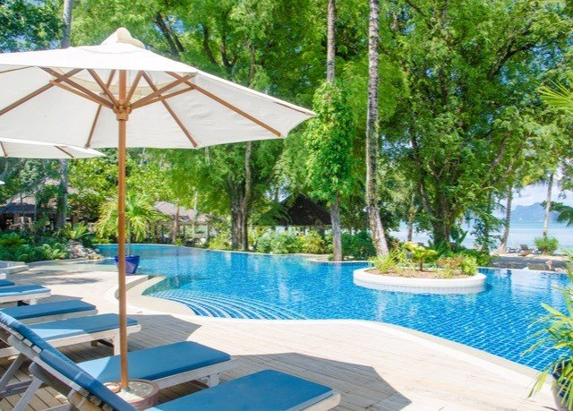 tree umbrella chair water Pool swimming pool lawn property leisure building Resort Deck Villa backyard shade cottage swimming set eco hotel outdoor structure empty lined sunny day