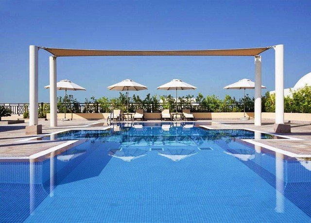 sky chair umbrella swimming pool building property Pool leisure leisure centre lawn Villa blue condominium Resort outdoor structure swimming Deck day