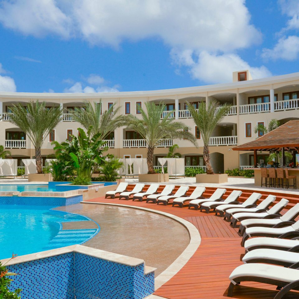 sky chair leisure swimming pool property Resort building condominium Pool home mansion Villa palace walkway lawn blue Deck