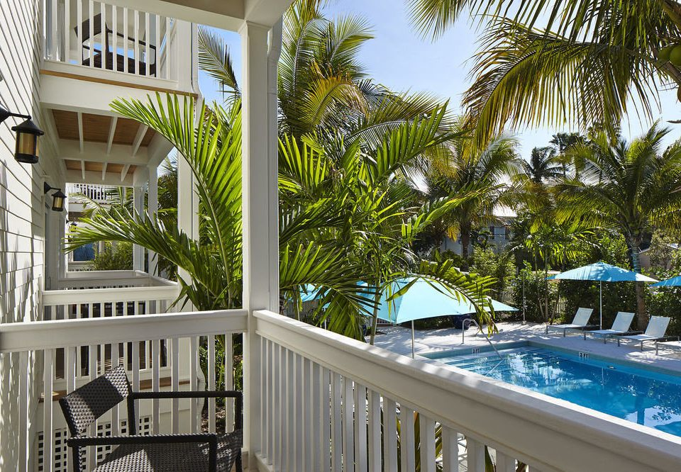 tree building chair property condominium Resort swimming pool home Villa Pool mansion cottage porch Deck palm