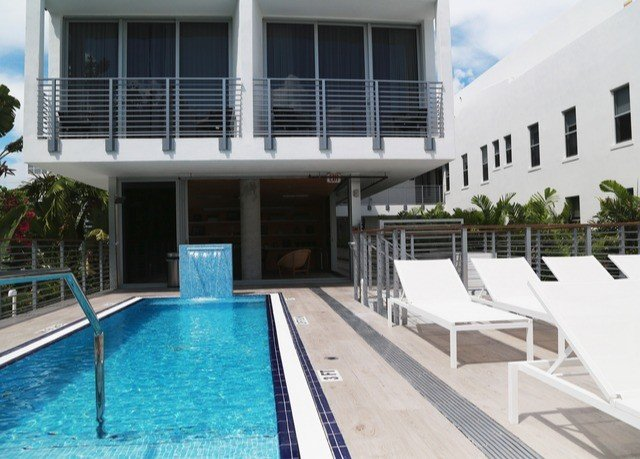 building condominium property swimming pool leisure centre Deck Villa Resort white Pool blue