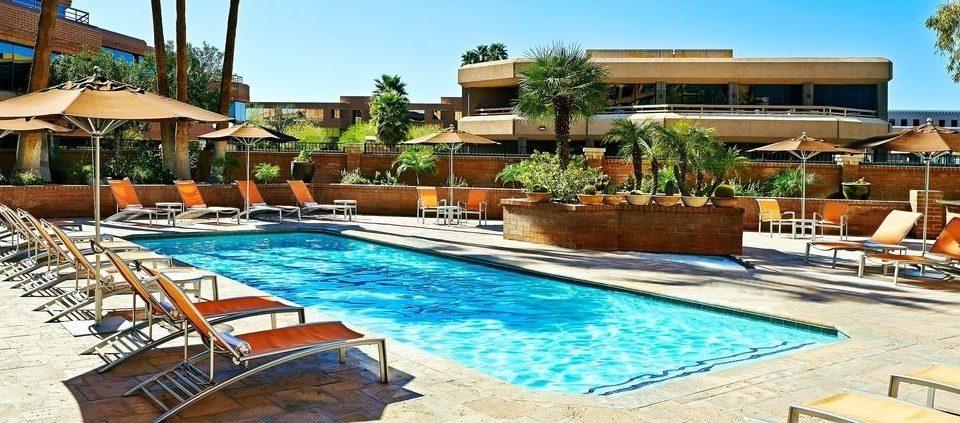 sky chair swimming pool property Resort building leisure Pool condominium Villa resort town backyard blue hacienda eco hotel Deck swimming