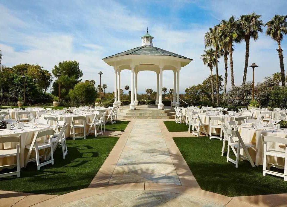 grass tree sky chair building lawn wedding aisle ceremony park function hall palace porch wedding reception Resort mansion set Deck colonnade