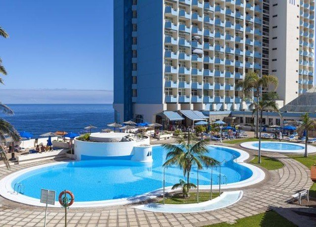 Resort condominium building property swimming pool leisure blue marina resort town Deck