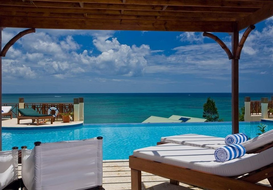 chair swimming pool property leisure caribbean Resort Villa cottage Sea overlooking Deck