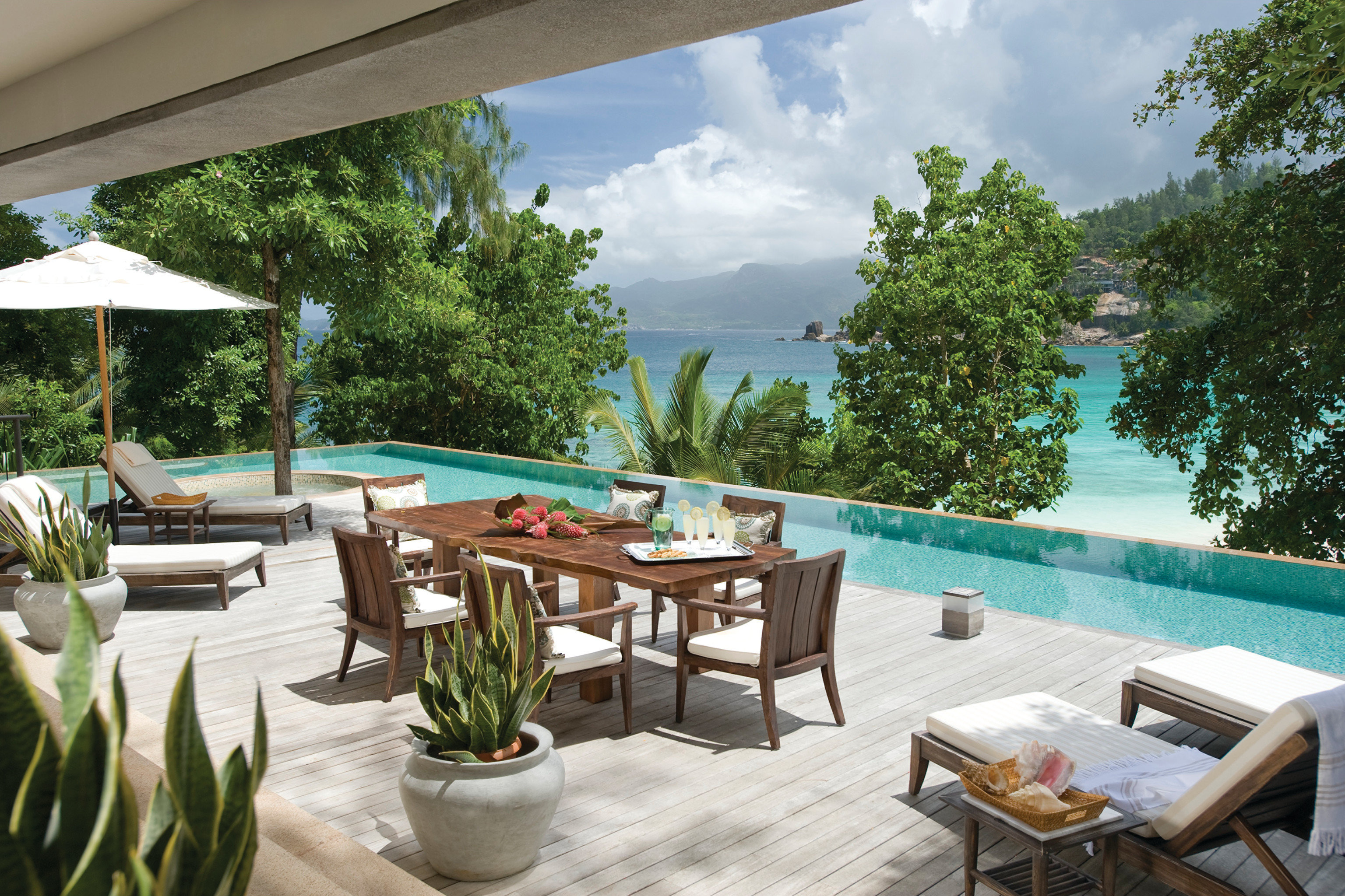 Trip Ideas tree property building Resort Villa swimming pool home backyard caribbean cottage condominium hacienda porch Deck