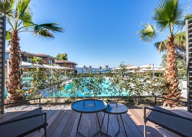 tree sky palm swimming pool property Resort condominium arecales marina caribbean Villa plant Deck shade lined