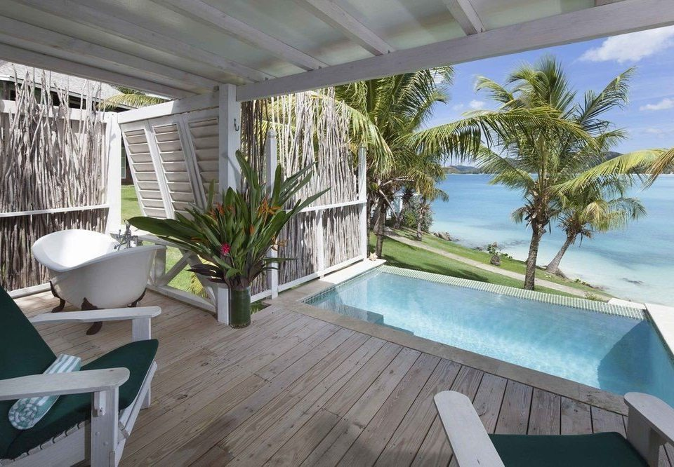 property swimming pool Villa house Resort condominium home backyard porch cottage outdoor structure caribbean mansion plant Deck