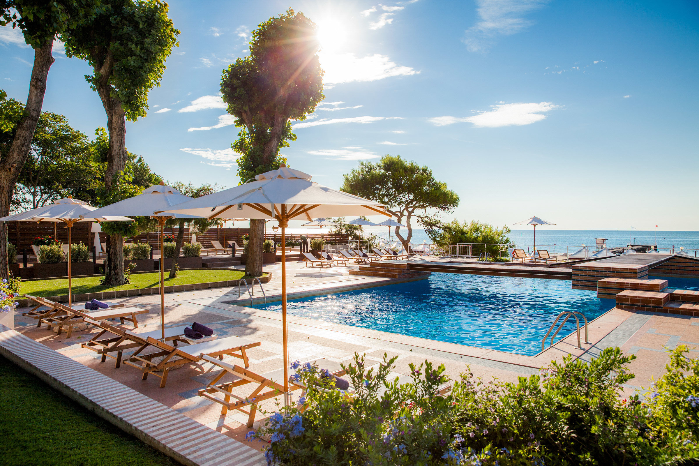 tree sky water swimming pool leisure property Resort Villa backyard condominium mansion shore Deck