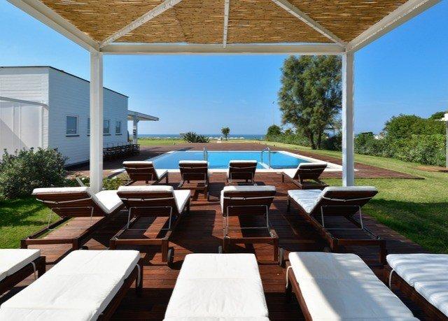 sky property swimming pool building Villa Resort outdoor structure backyard overlooking Deck