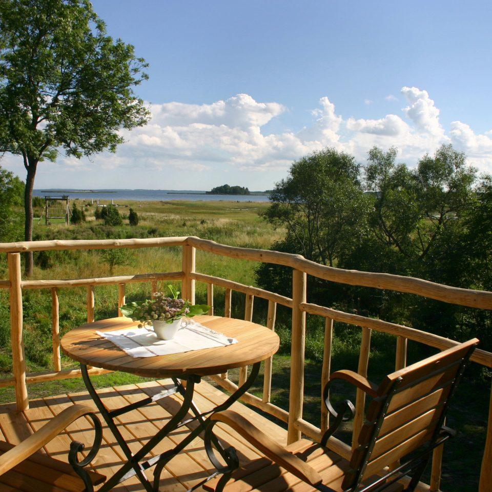 tree chair building property wooden Resort backyard cottage Villa home Deck porch set