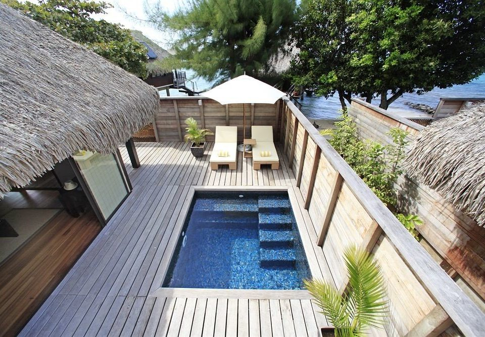 tree property swimming pool wooden Resort Villa cottage backyard home outdoor structure condominium mansion Deck