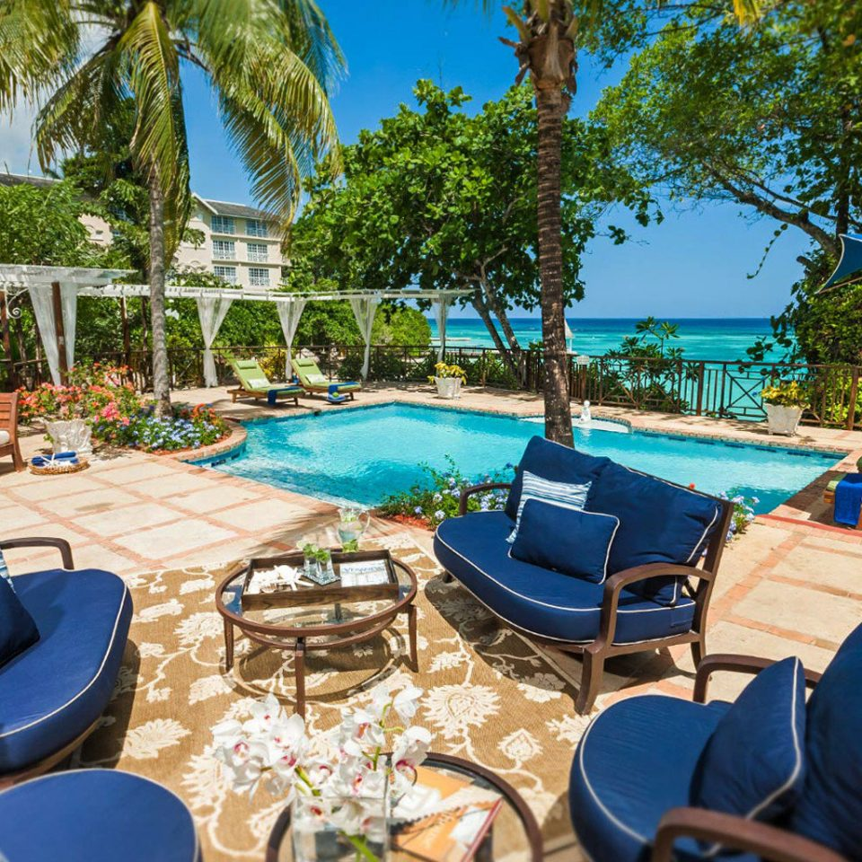 tree sky chair leisure property Resort swimming pool lawn Villa backyard caribbean eco hotel Deck set sunny shade day