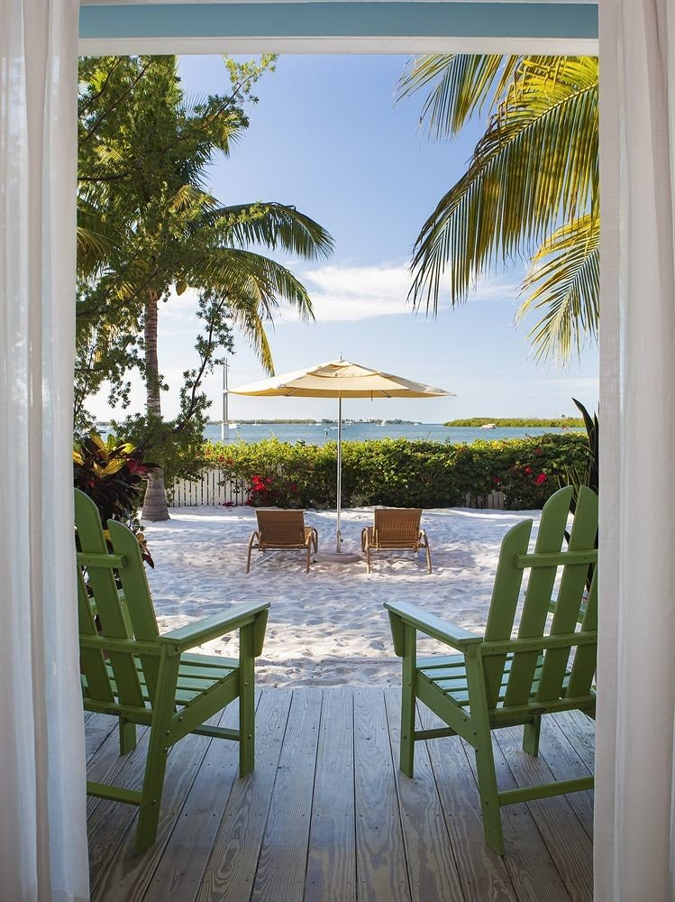 tree chair property porch home house Resort caribbean swimming pool Villa backyard mansion condominium cottage Deck