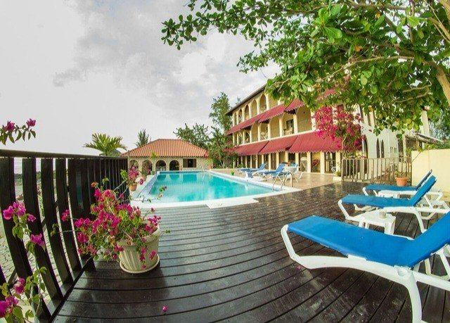 tree property Resort chair swimming pool leisure Villa condominium caribbean backyard hacienda blue cottage eco hotel porch Deck