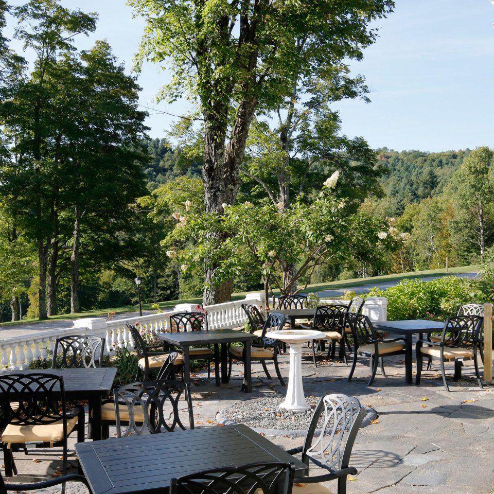 tree ground chair building porch Resort home park backyard cottage Villa restaurant shade Deck