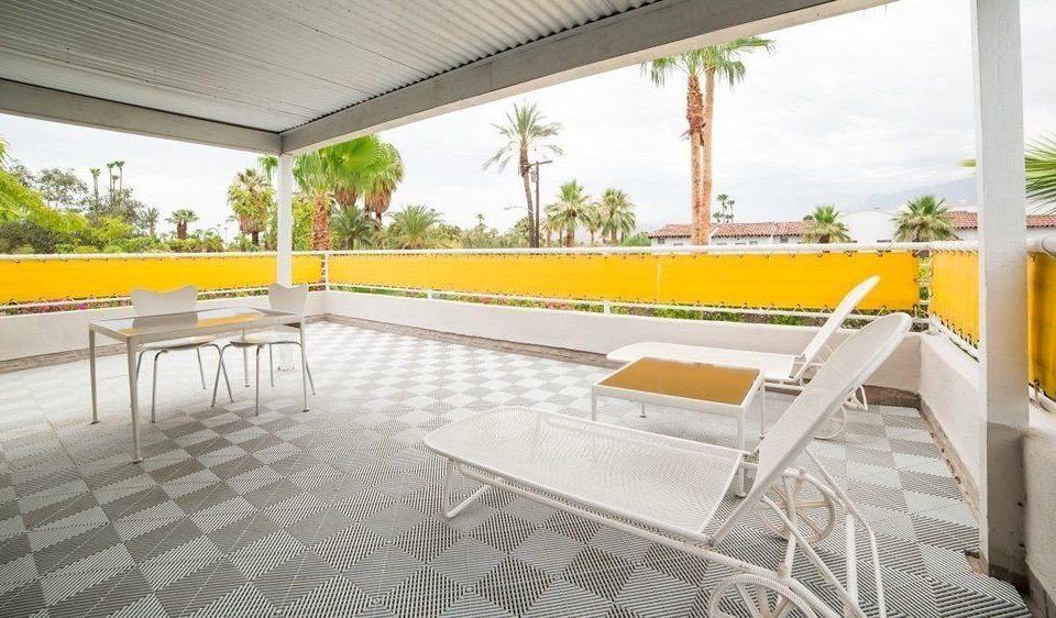 building leisure property porch Villa yellow Resort swimming pool condominium hacienda outdoor structure backyard Deck