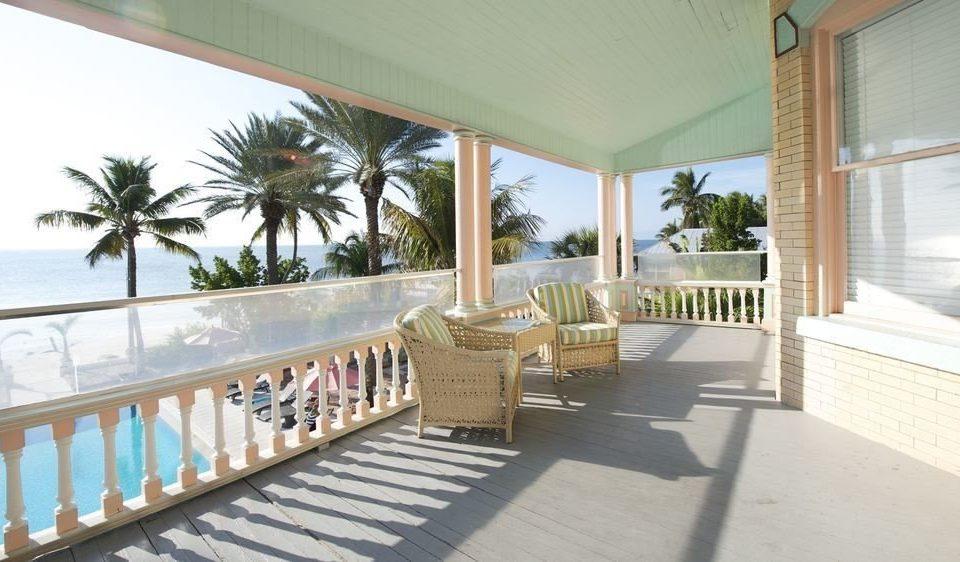 building property porch Villa Resort condominium swimming pool home cottage mansion Deck hacienda caribbean