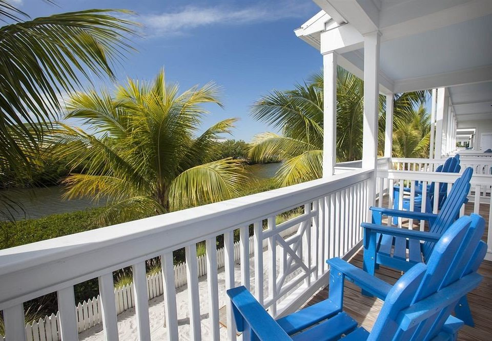 tree porch chair building property Resort Deck house caribbean home Villa swimming pool condominium cottage white