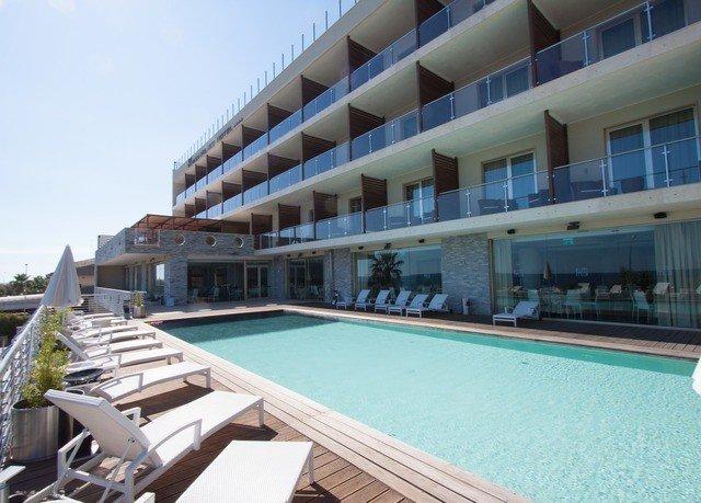property condominium swimming pool building Resort leisure centre Villa Deck