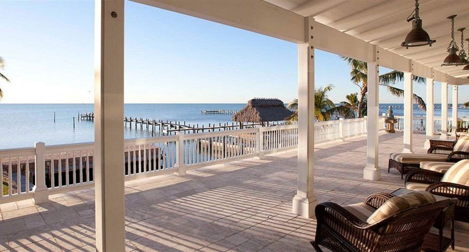 chair property Resort Villa condominium home caribbean cottage Deck mansion porch overlooking empty colonnade