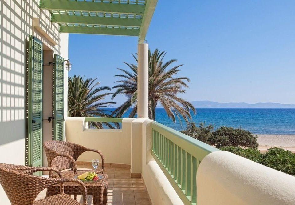 sky property chair condominium swimming pool Resort home Villa caribbean overlooking cottage porch Deck