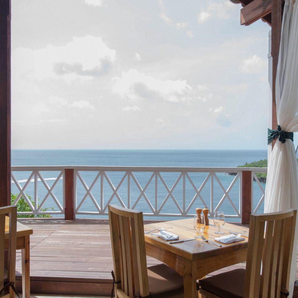 chair sky property Resort Villa home cottage wooden caribbean Deck porch set day