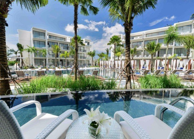 tree condominium property swimming pool Resort Villa resort town mansion palm Deck