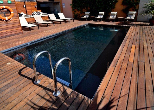 swimming pool chair wooden property Deck hardwood outdoor structure backyard Villa