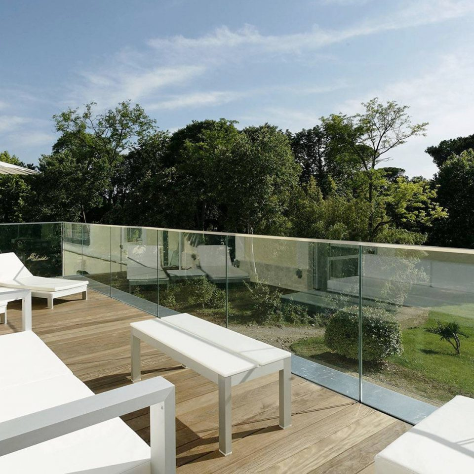 tree property swimming pool Villa condominium home outdoor structure backyard landscape architect Deck