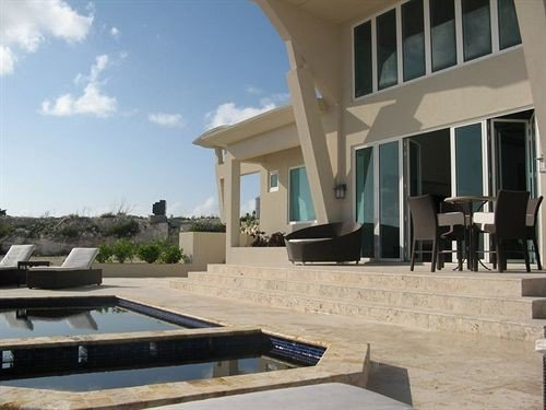 sky building property swimming pool Villa condominium home outdoor structure mansion Deck colonnade