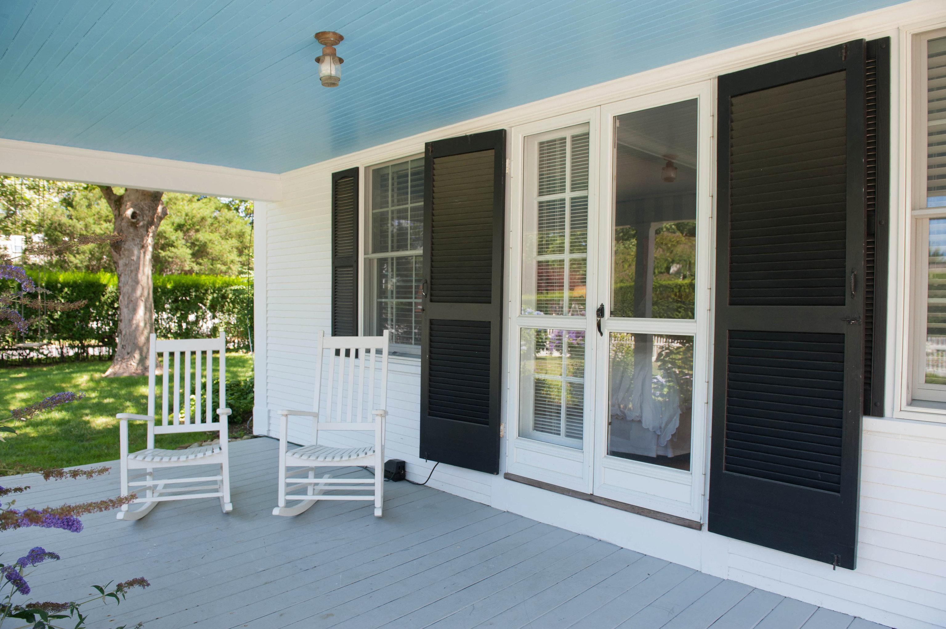 porch property building house home outdoor structure condominium siding door cottage Villa Deck