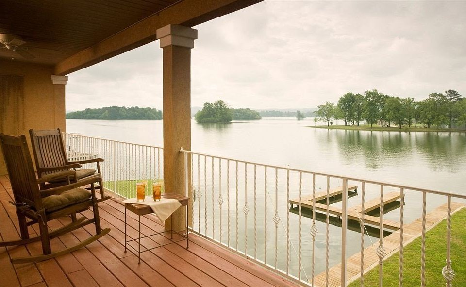 water building property overlooking porch swimming pool Villa cottage home condominium outdoor structure Deck