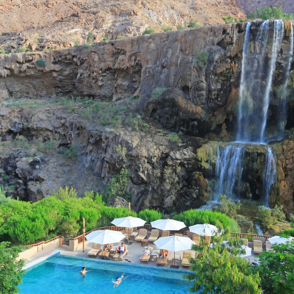 Desert Grounds Pool Waterfall Nature rock mountain valley water feature terrain wadi surrounded